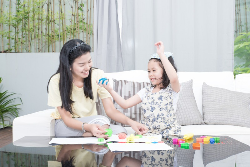 family, children and happy people concept - Asian mother and kid