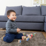 Asia little boy play toy block