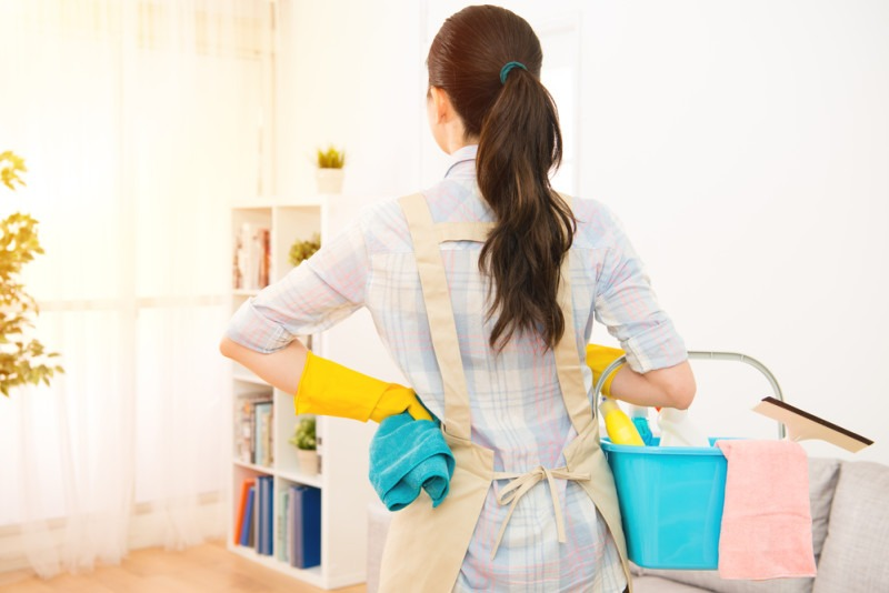 woman preparing to clean living room