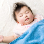 Asian baby girl sleeping on the towel