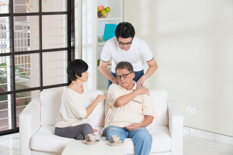 asian man with injured shoulder father