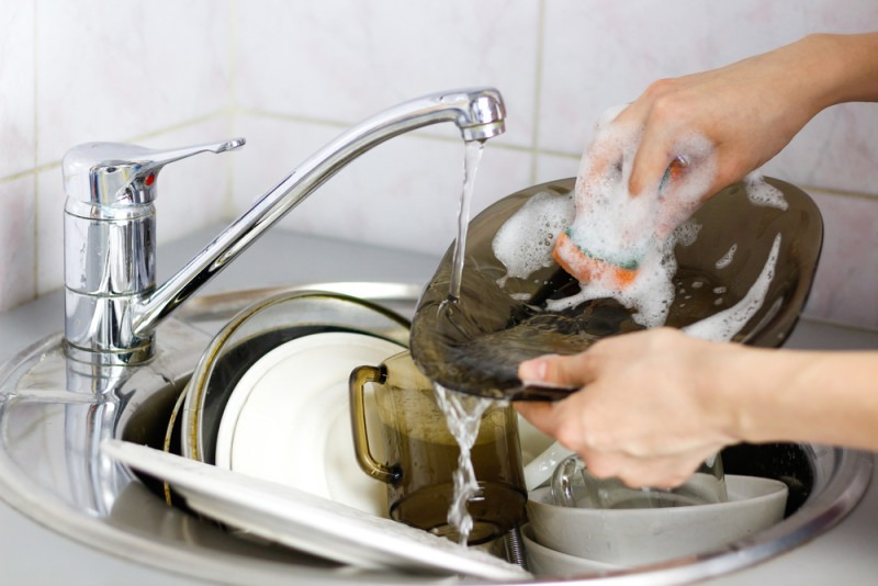 Image result for someone washing dishes