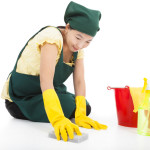 smiling Service woman cleaning the floor
